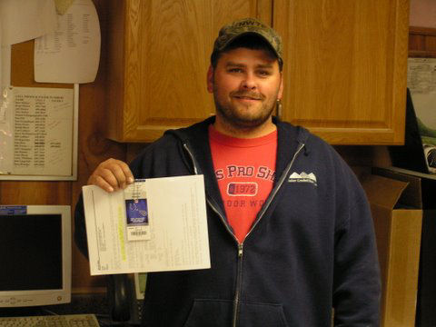 Chris Orman poses with his Colts tickets