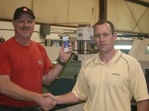 Chuck Mosby accepts Colts tickets from Bart Mulzer