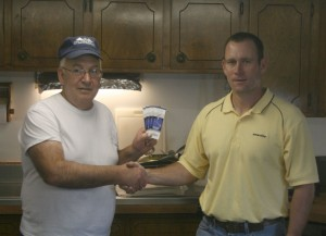 Don Winkler accepts Colts tickets from Bart Mulzer