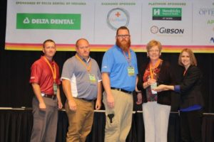 MCS Employees (from left to right) Stewart Colin, Chad Lewis, Brandon Hundley, and Shari Everly accept the AchieveWELL Award in Indianapolis.